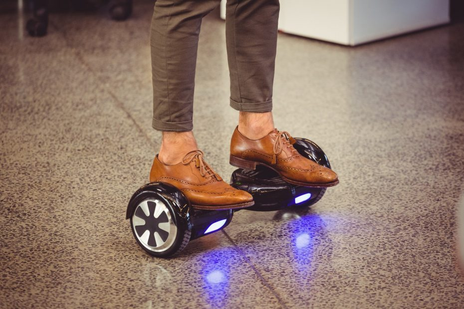 Business executive standing on hoverboard