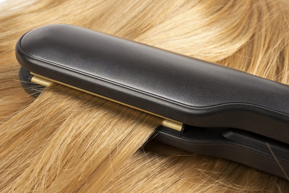 Straightening long blond hair with hair irons